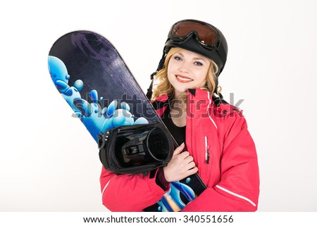 Portrait of a happy young girl snowboarding. Girl and snowboarding. girl in a red jacket holding a snowboard
