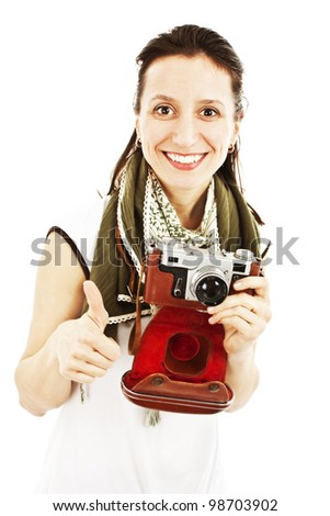 Portrait of a happy young girl with an old camera showing thumbs up sign. Isolated on white background - stock photo