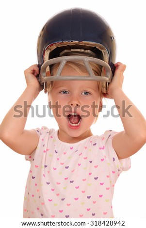 Portrait of a happy young girl with football helmet on white background - stock photo