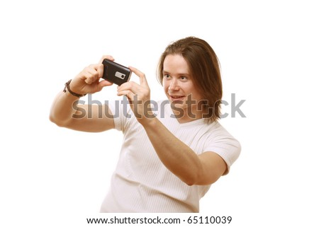 Portrait of a happy young guy taking picture - stock photo