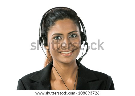 Portrait of a happy young Indian female call center employee with a headset. Isolated on a white background. - stock photo