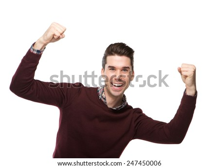 Portrait of a happy young man cheering with arms raised on isolated white background - stock photo