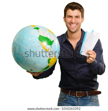 Portrait Of A Happy Young Man With Globe And Boarding Pass Isolated On White Background