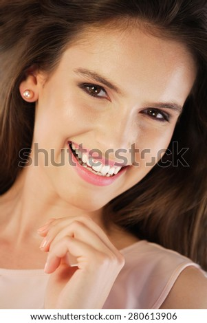 Portrait of a happy young woman. Head shot - stock photo