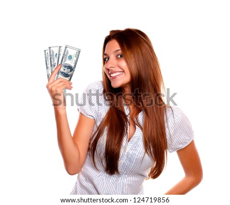 Portrait of a happy young woman holding up cash money while is looking at you on isolated background - stock photo