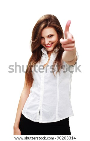 Portrait of a happy young woman pointing at you against white background - stock photo