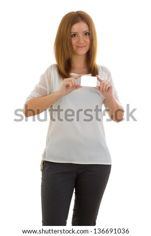 Portrait of a happy young woman showing her bussiness card against white background