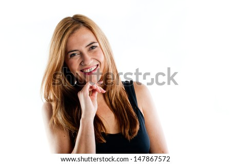 Portrait of a happy young woman smiling at the camera - stock photo