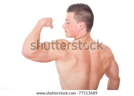 Portrait of a healthy young man showing his arms against white background - stock photo