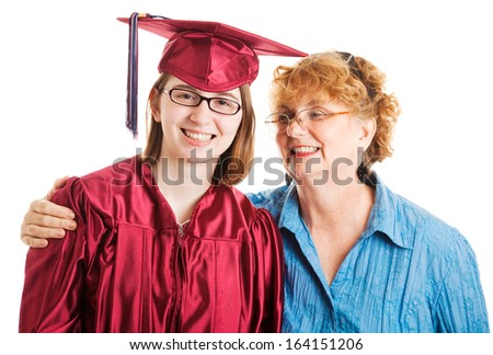 Portrait of a high school graduate and her proud mother.  Isolated on white.   - stock photo