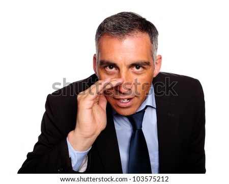 Portrait of a hispanic senior executive telling a confidence against white background - stock photo