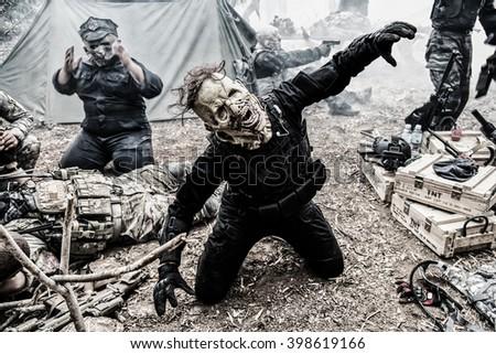 portrait of a horrible scary zombie men with dark tone. Horror. Halloween.  - stock photo