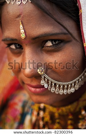 Portrait of a India Rajasthani woman - stock photo