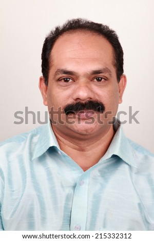 Portrait of a Indian middle aged man - stock photo