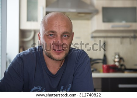 Portrait of a jolly bald man in the interior - stock photo
