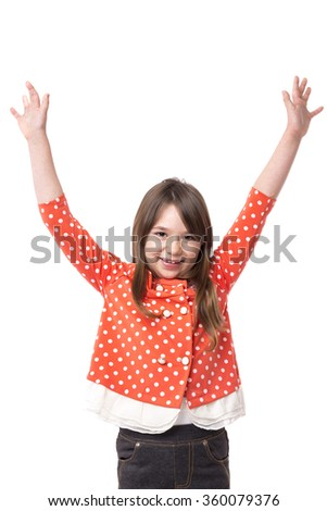 Portrait of a joyful little girl  with arms raised over white background - stock photo