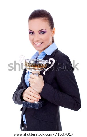 Portrait of a joyful young female entrepreneur holding a trophy against white background - stock photo