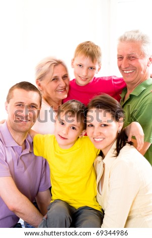 portrait of a large family in the room - stock photo