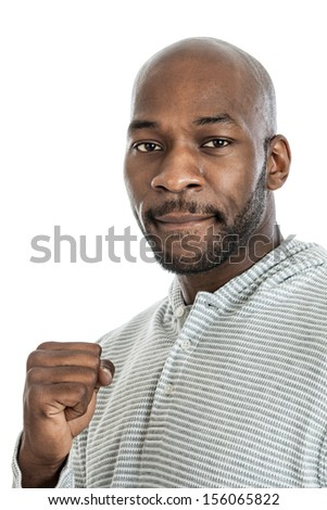 Portrait of a late 20s black man looking tough making a fist isolated on a white background - stock photo