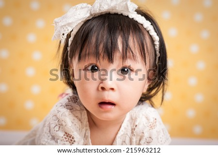 Portrait of a liitle girl close-up - stock photo