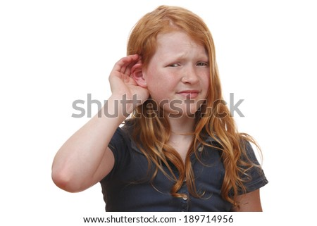 Portrait of a listening young girl on white background - stock photo