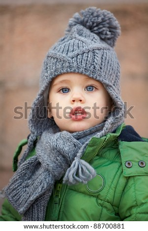 Portrait of a little baby boy wearing a cute hat in autumn. - stock photo