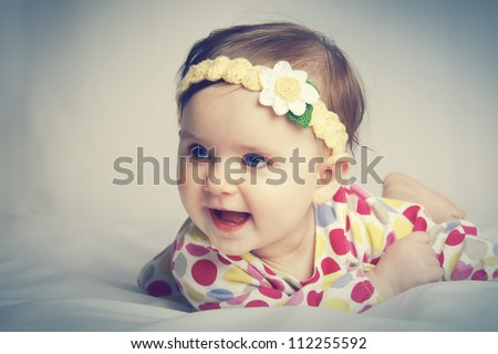 Portrait of a little beautiful baby - stock photo