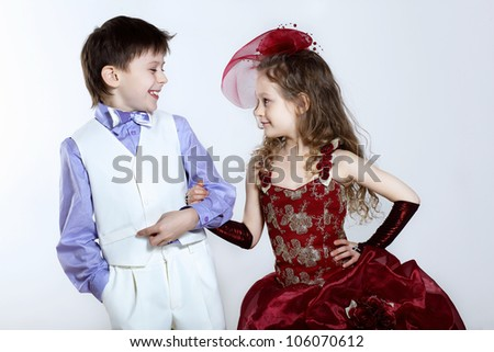 Portrait of a little boy and girl in beautiful dress - stock photo
