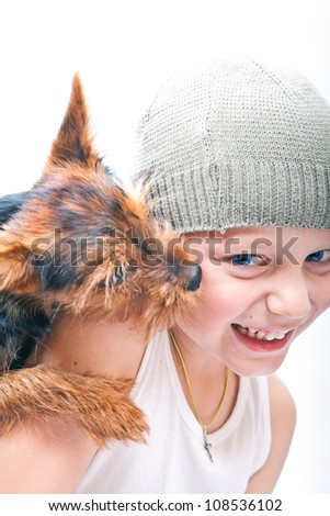 portrait of a little boy and puppy - stock photo
