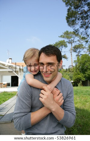 Portrait of a little boy embracing a man - stock photo