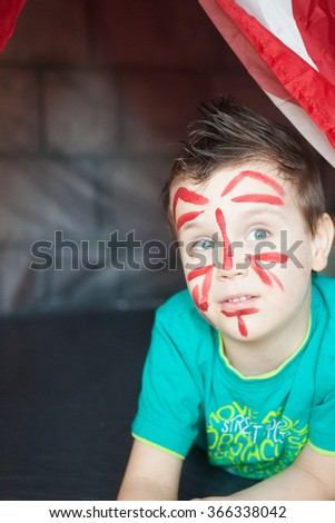 Portrait of a little boy enjoying his painting. Education. - stock photo