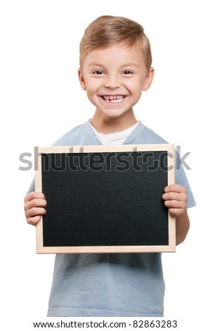 Portrait of a little boy holding a blackboard over white background - stock photo