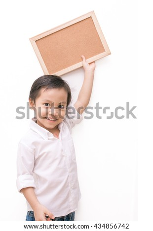portrait of a little boy holding a board over white background - stock photo