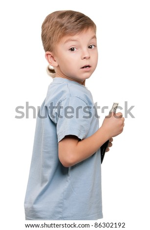 Portrait of a little boy holding a dollars over white background