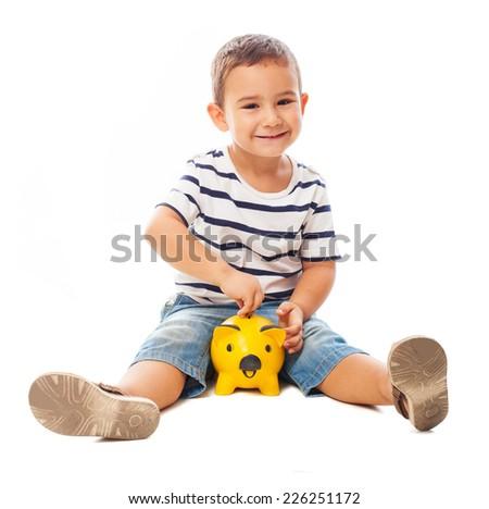 portrait of a little boy holding a piggy bank - stock photo