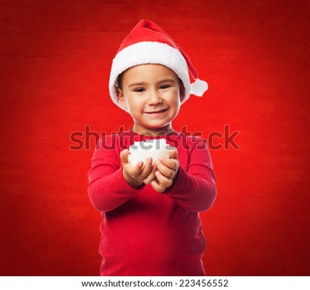 portrait of a little boy holding a snowball - stock photo