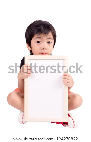 Portrait of a little boy holding a whiteboard over white background - stock photo