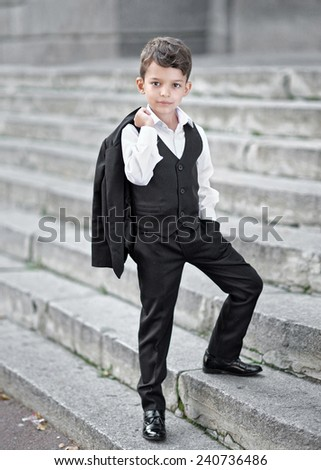 portrait of a little boy in a business style - stock photo