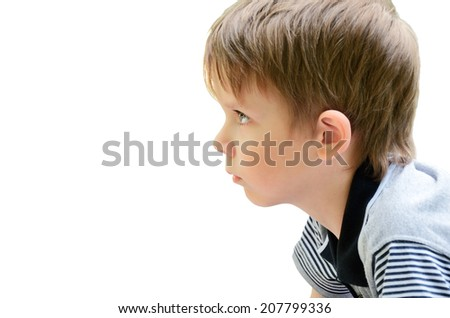 portrait of a little boy in profile. isolated on white background. focus on eyes