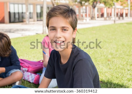 Portrait of a little boy in school campus - stock photo