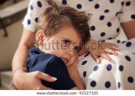 Portrait of a little boy in the arms of mother - stock photo