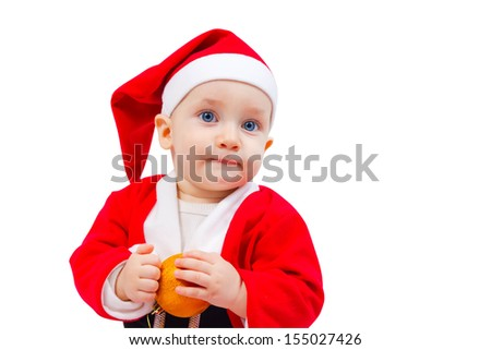 Portrait of a little boy in the costume of Santa Claus with a decoration for the Christmas tree isolated on white background - stock photo