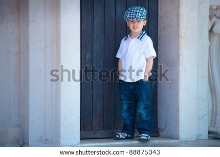 Portrait of a little boy playing outdoors in a winter forest - stock photo
