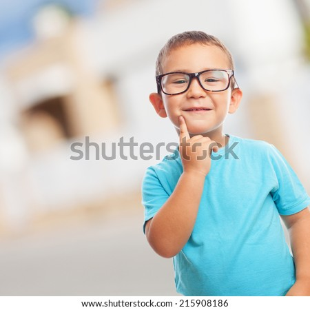 portrait of a little boy playing with a wooden plane - stock photo