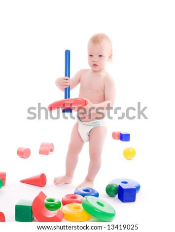 Portrait of a little boy playing with bright geometric toys on playground. Image isolated on white with light shadows