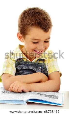 Portrait of a little boy reading a book - stock photo