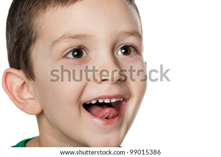 Portrait of a little boy, which is something impressed; isolated on the white background - stock photo