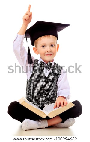 Portrait of a little boy with a book. Isolated over white background. - stock photo