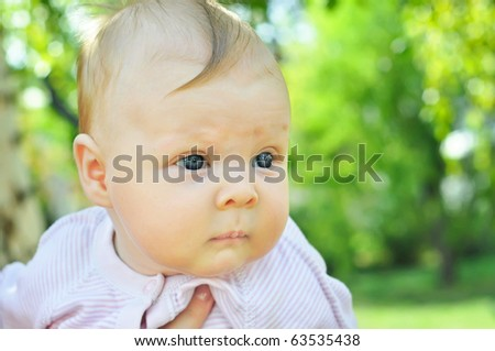 Portrait of a little cute  smiling baby-girl - stock photo