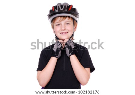 Portrait of a little cyclist  in a helmet - stock photo
